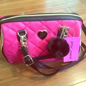 Brand new tags on Betsey Johnson bag.